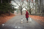 Girl red dress walking dogs