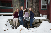 Four cousins with snow on their butts