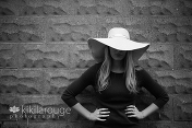 Portrait with face hidden by large hat