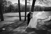 Couple portrait with wedding dress blowing